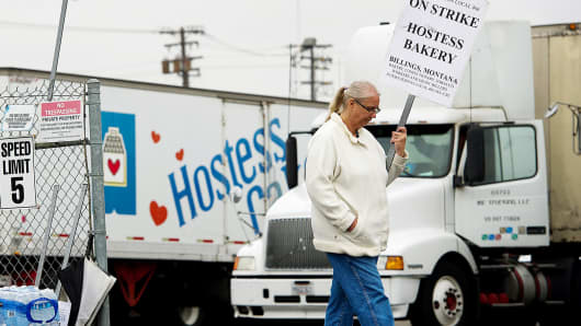 A production worker for Hostess Brands pickets in Sacramento, Calif., in November.