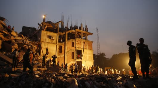 Rescue workers look for trapped garment workers in the collapsed Rana Plaza building in Savar.
