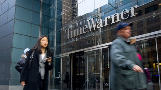 Pedestrians walk past the Time Warner Center building in New York, U.S.