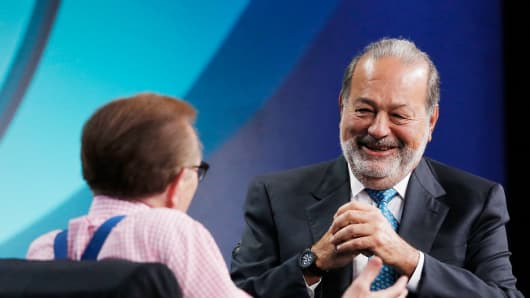 Larry King, left, speaks with billionaire Carlos Slim at the annual Milken Institute Global Conference.