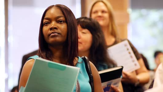 Job seekers line up to meet with a recruiter during a job fair at the Alameda County Office of Education on April 24, 2013 in Hayward, California.
