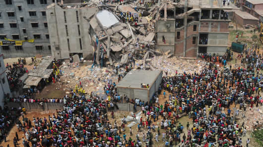 Rescuers at the scene after the Bangladesh building collapse in April.