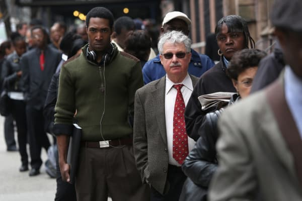 Hundreds line up to attend a job fair in New York in April.