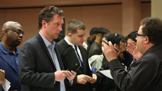 Job seekers meet meet potential employers at a career fair on April 18, 2013 at the Holiday Inn in Midtown in New York City.