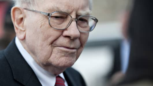 Warren Buffett, chairman and chief executive officer of Berkshire Hathaway Inc., speaks to members of the media outside the Bridge Center in Omaha, Nebraska, U.S.
