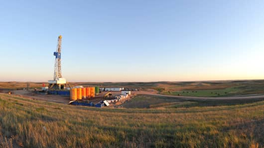 An oil drilling rig is seen drilled into the Bakken Formation, one of the largest contiguous deposits of oil and natural gas in the United States.