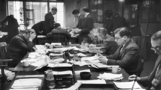The newsroom of the News of the World newspaper on Fleet Street, 18th April 1953.