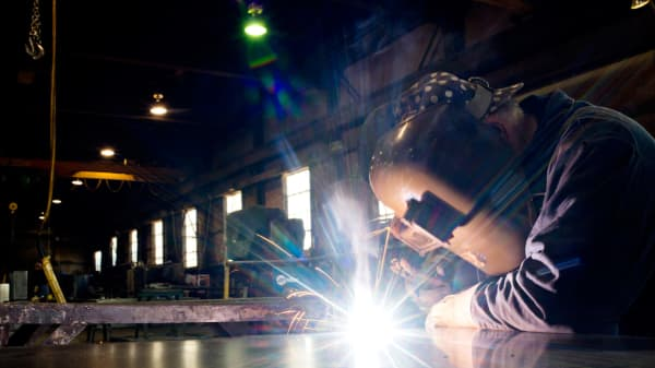 A welder builds parts for finished petroleum tanks at Southern Tank and Manufacturing Inc. in Owensboro, Kentucky, U.S.