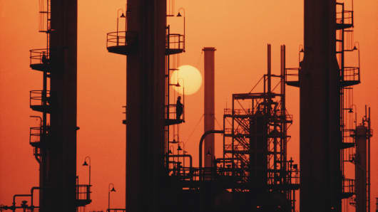 The sun sets over an oil refinery in Saudi Arabia.
