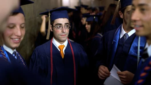 Steve Heiss stands with fellow graduates before participating in commencement ceremonies from the University of Illinois at Urbana-Champaign on May 11, 2013.