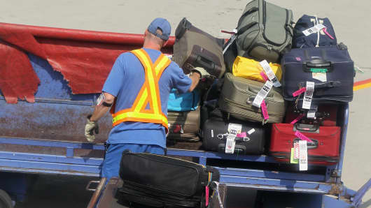 Luggage being loaded on to a jet at Long Island MacArthur Islip airport.
