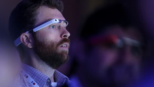 An attendee wears Google Glass as he watches the opening keynote at the Google I/O developers conference at the Moscone Center on May 15, 2013 in San Francisco, California.