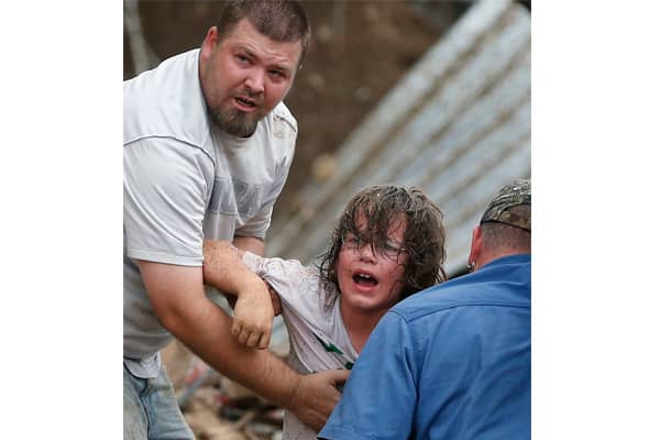 A child is rescued from the debris following a devastating tornado that ripped through Moore, Oklahoma.