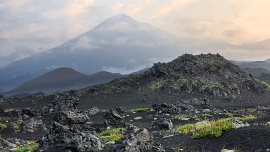 Kamchatka twilight landscape with Tolbachik volcano on background