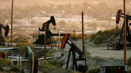 Oil rigs just south of town extract crude in Taft, California.