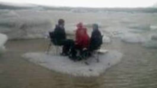 A cellphone photo of the picnicking American tourist group before they were rescued from an ice slab that broke off in Iceland.