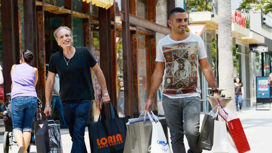 Shoppers walk down the Third Street Promenade's outdoor shopping mall in Santa Monica, California.