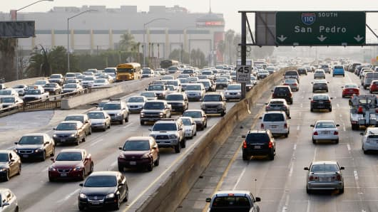 Traffic on the northbound and southbound lanes of the 110 Harbor Freeway starts to stack up during rush hour traffic in Los Angeles, California.