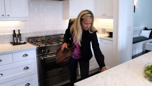 Stephanie O'Brien inspects the kitchen in a home for sale during an open house in San Francisco, California.