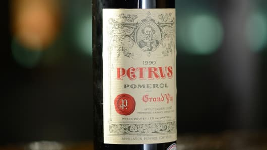 A bottle of the finest wine from the cellars of the Elysee Palace, a 1990 Pomerol Chateau Petrus.