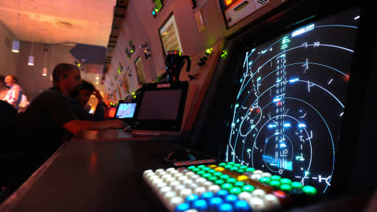 Inside Denver's TRACON or Terminal Radar Approach Control center at DIA.