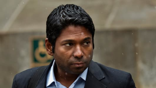 Rengan Rajaratnam, founder of Sedna Capital Management and the younger brother of imprisoned hedge fund founder Raj Rajaratnam, exits federal court in New York.