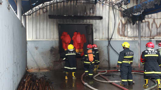 Firefighters do rescue works after a fire at a poultry slaughterhouse in Dehui, Jilin Province of China.