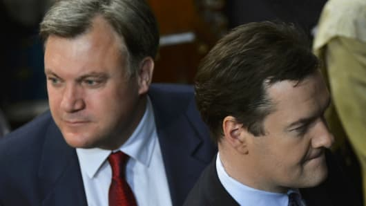 Britain's Chancellor of the Exchequer George Osborne (R) and shadow chancellor Ed Balls