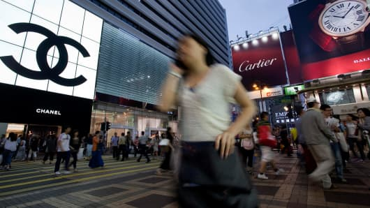 Chanel and Cartier logos are displayed on stores in Hong Kong.