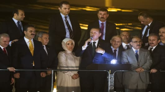 Turkish Prime Minister Recep Tayyip Erdogan speaks to thousands of his supporters who greeted the prime minister at Istanbul airport on his return from a North African tour.