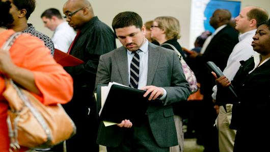 A man waits to speak to a U.S. Department of State job recruiter at the Choice Career Fairs job fair in Arlington, Virginia, U.S.