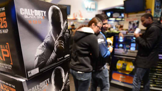 A gamer hugs her boyfriend as they wait for midnight to buy 'Call Of Duty: Black Ops II,' Activision's news release in the 'Call of Duty' series, at a Game Stop store in Universal City, California