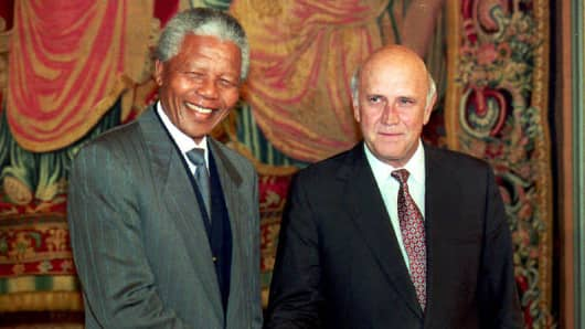Nelson Mandela and Frederik de Klerk shake hands on the eve before receiving jointly the Nobel Peace prize in 1993.