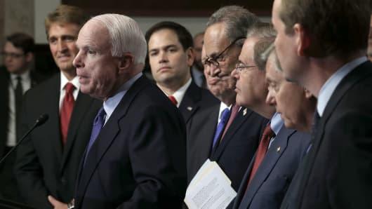 Sen. John McCain (R-AZ) (2nd L) speaks as (L-R) Sen. Jeff Flake (R-AZ), Sen. Marco Rubio (R-FL), Sen. Richard Durbin (D-IL), Sen. Chuck Schumer (D-NY), Sen. Bob Menendez (D-NJ), Sen. Lindsey Graham (R-SC), and Sen. Michael Bennet (D-CO), also known as the Gang of Eight