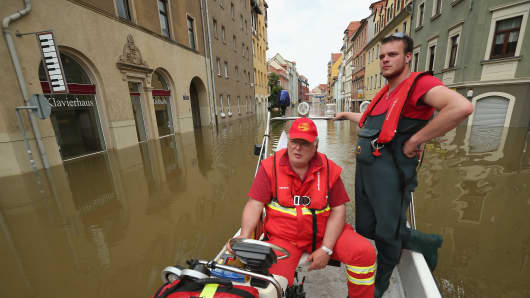 Firemen evacuate residents from a district flooded by the Saale river in Meissen, Germany. Flooding in some areas of eastern and southern Germany is the worst in 400 years. At least four people are dead and tens of thousands have been forced from their homes.