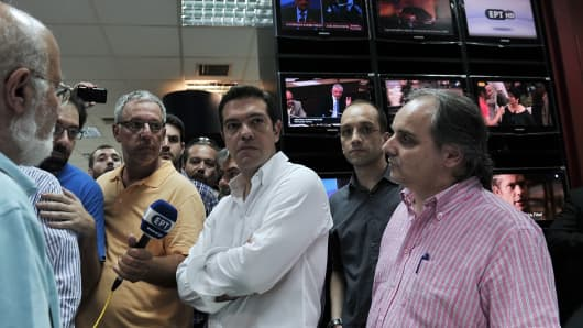 Greek main opposition party leader Alexis Tsipras (C) talks with employees of the ERT public broadcaster to express his support at the headquarters studio in Athens on June 11, 2013.