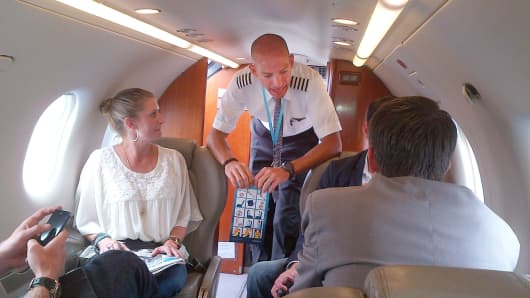 Pilot speaks with passengers on initial Surf Air flight