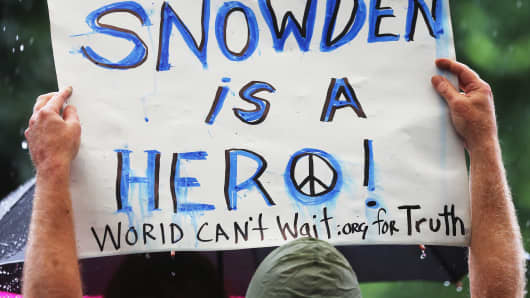 A supporter holds a sign at a small rally in support of National Security Administration (NSA) whistleblower Edward Snowden in Manhattan's Union Square on June 10, 2013 in New York City.