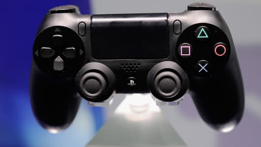 A Playstation 4 and its controller is on display at the Sony Playstation E3 2013 booth at the Los Angeles Convention Center.