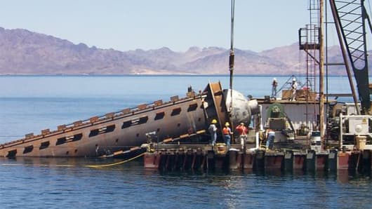 An intake shaft liner being lowered into place during water project construction on Lake Mead in Nevada.