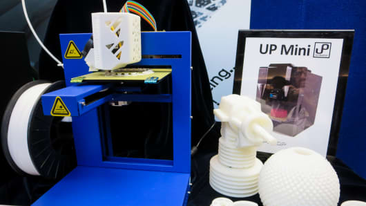 A 3-D printer on display at RAPID, an additive manufacturing conference in Pittsburgh, Pa.