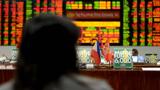 A trader looks at a stocks monitor at the Philippine Stock Exchange in Manila. The market, together with stocks in other emerging markets, were hit hard last week.