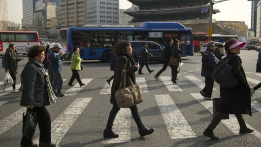 Commuters on street in Seoul.