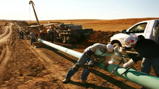 An Alpha Oil & Gas crew building a 10-inch gas pipeline near Watford City, N.D.