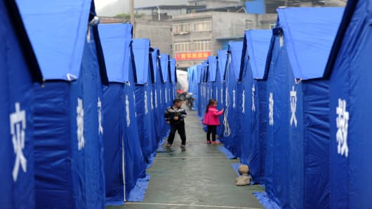 Children playing at a temporary refugee tent settlement Yaan, southwest China's Sichuan province, after the devastating earthquake in April.