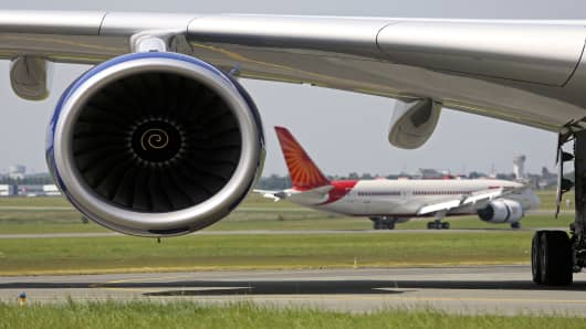 A Boeing Co. 787 Dreamliner aircraft passes behind the engine of a Airbus SAS A380 aircraft on the first day of the Paris Air Show.