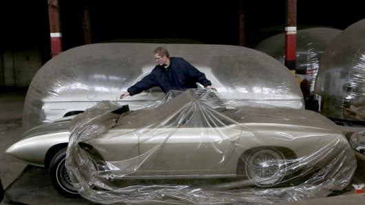 Curator Adam Lovell deflates a car capsule housing a 965 Ford XD Cobra prototype owned by the Detroit Historical Society.