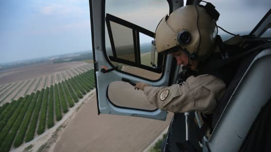 U.S. Border Patrol agent Ryan Bell looks for drug smugglers along the Rio Grande.