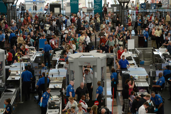 Airline travelers getting through security on the south side of Denver International Airport.
