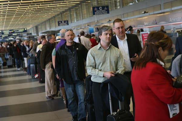 American Airlines passengers wait in line at O'Hare Airport, Chicago.